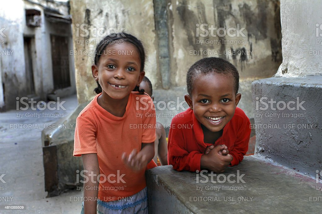 African, dark skinned children, about 5 years old, playing outdor stock photo