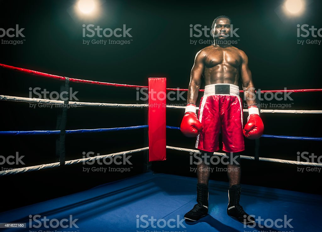 African descent boxer in boxing ring stock photo