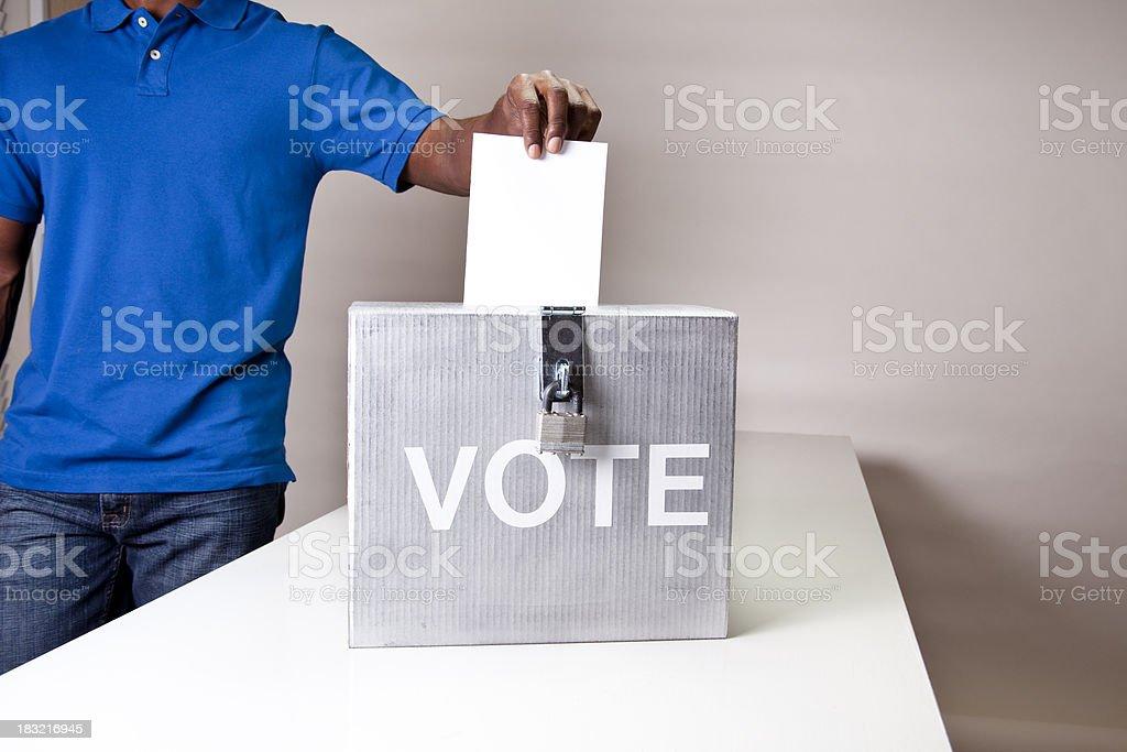 African descent man casting his vote. Ballot box. stock photo