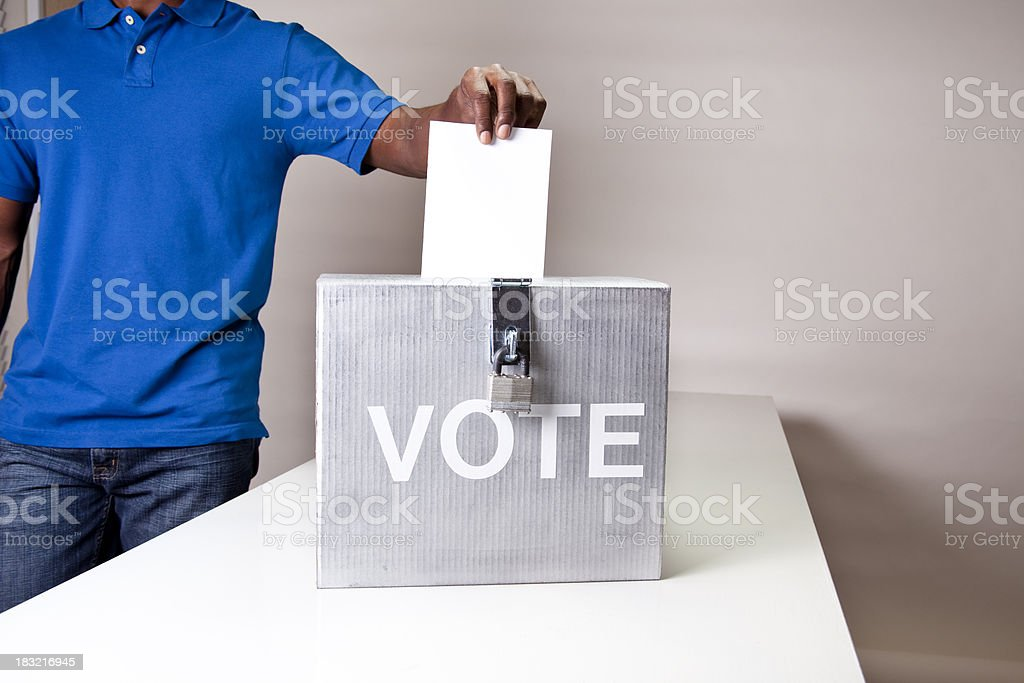 African descent man casting his vote. Ballot box. stock photo