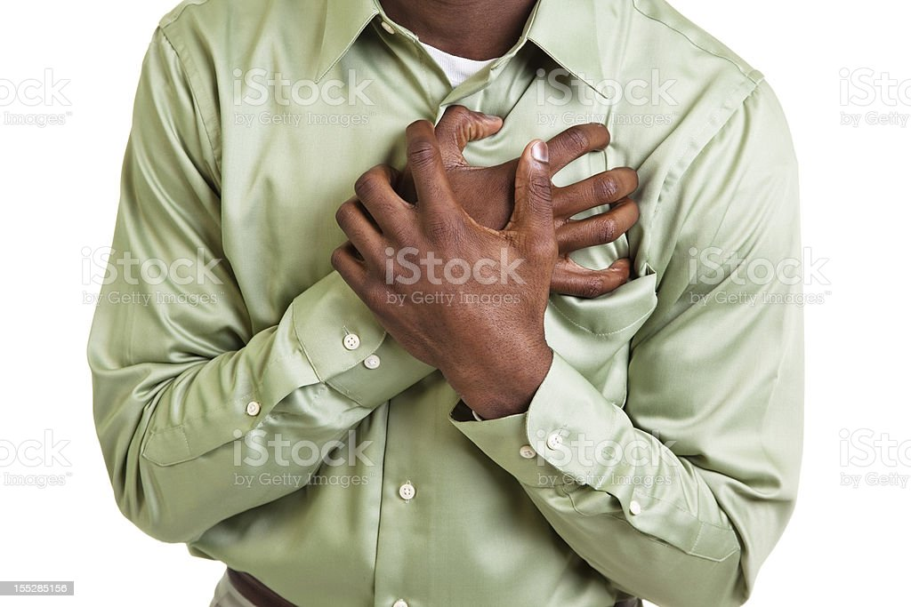 African descent man clutching his chest. Pain, heart attack. Male. stock photo