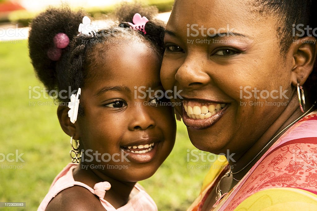 African descent mother and daughter close-up. Outdoors. stock photo