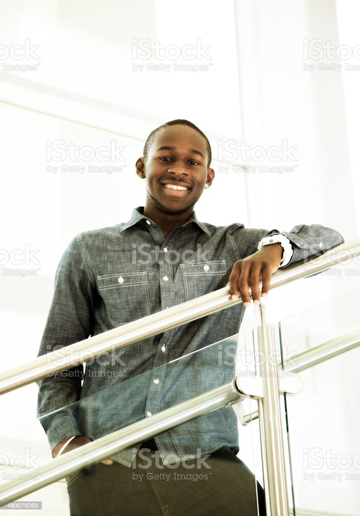 African descent teen on high school or college campus. Smiling. royalty-free stock photo