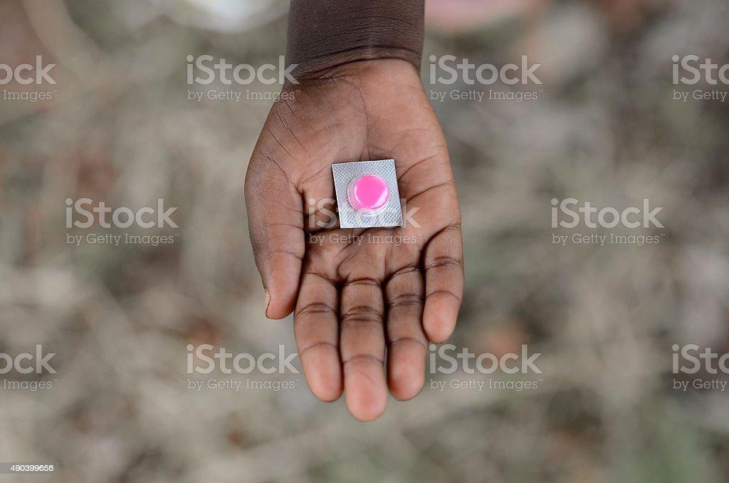 African Diseases Symbol African Boy Holding Pills Medicine Doctor Hospital stock photo