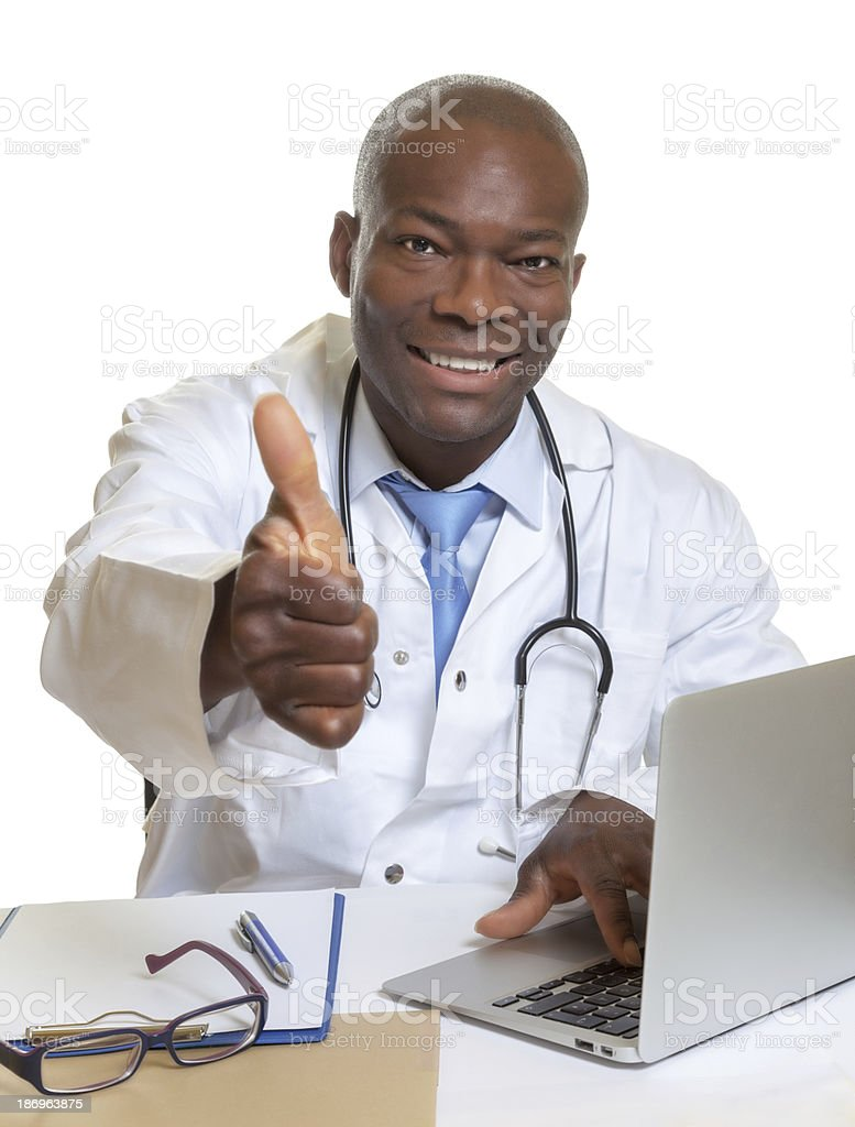 African doctor works at his computer royalty-free stock photo