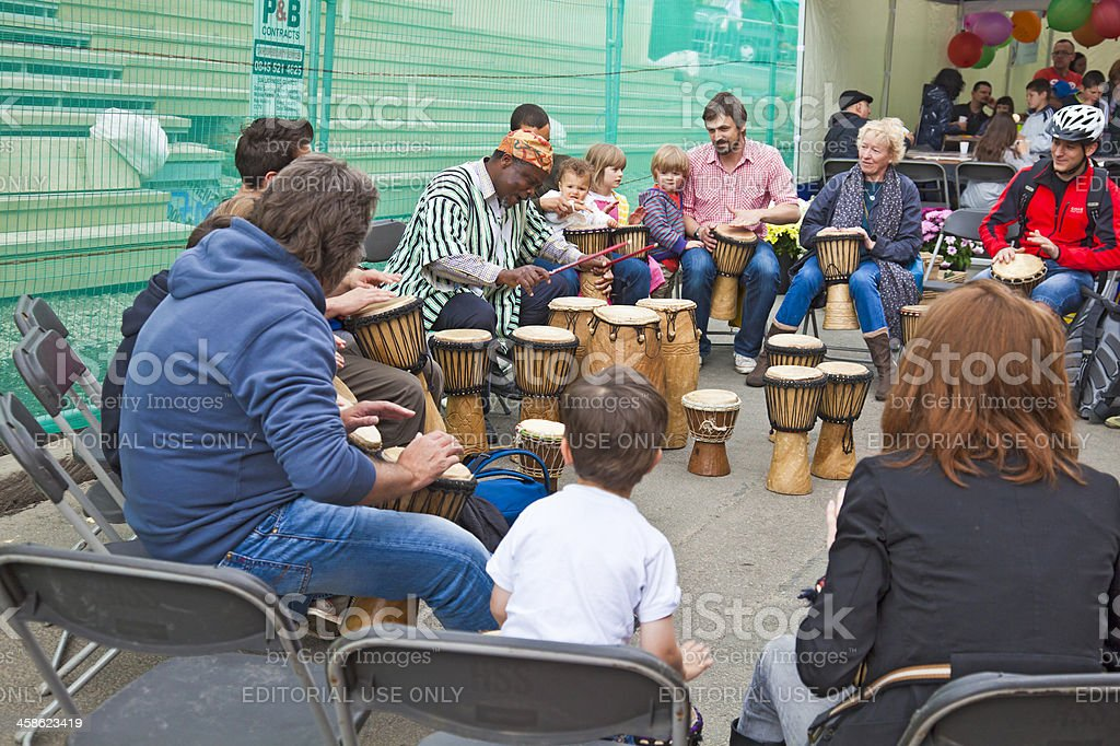 African drummer teaching drumming in Glasgow stock photo