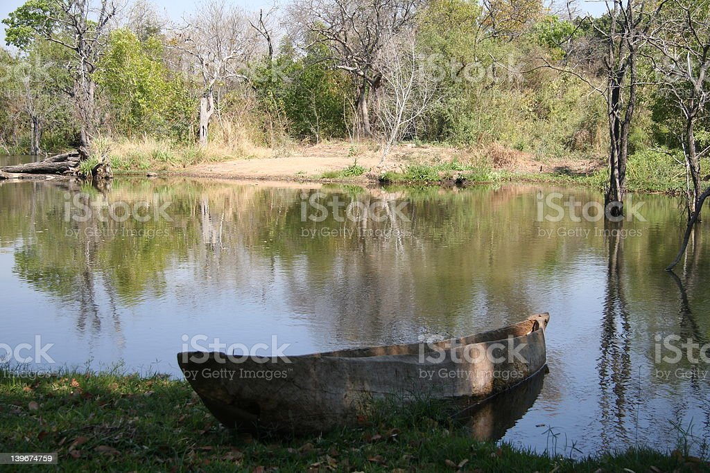african dugout canoe in river royalty-free stock photo