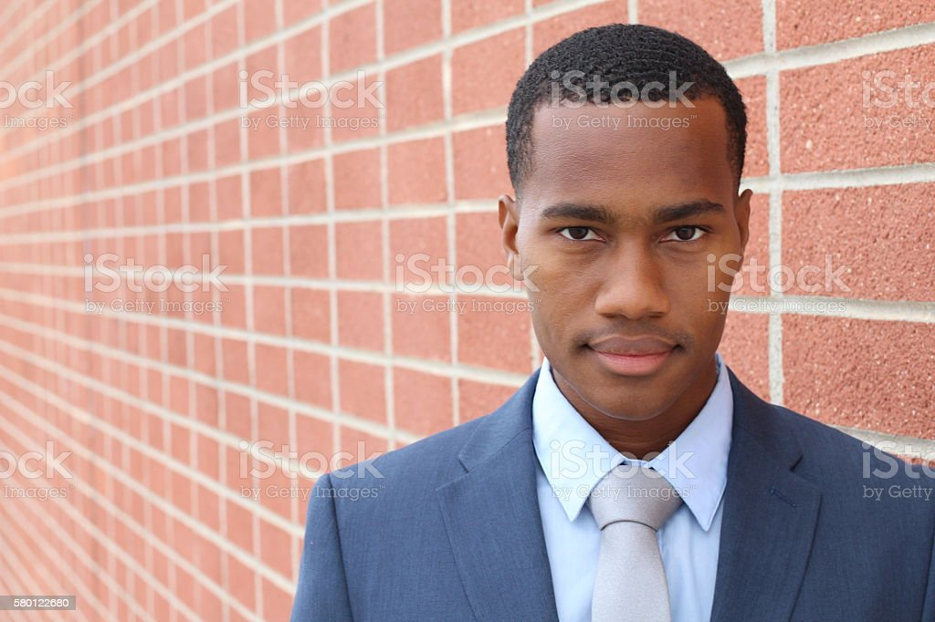 African entrepreneurial achiever looking confidently stock photo