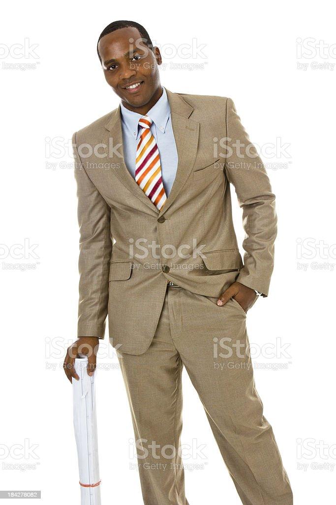 African ethnicity man wearing suit holding blueprints, white background stock photo