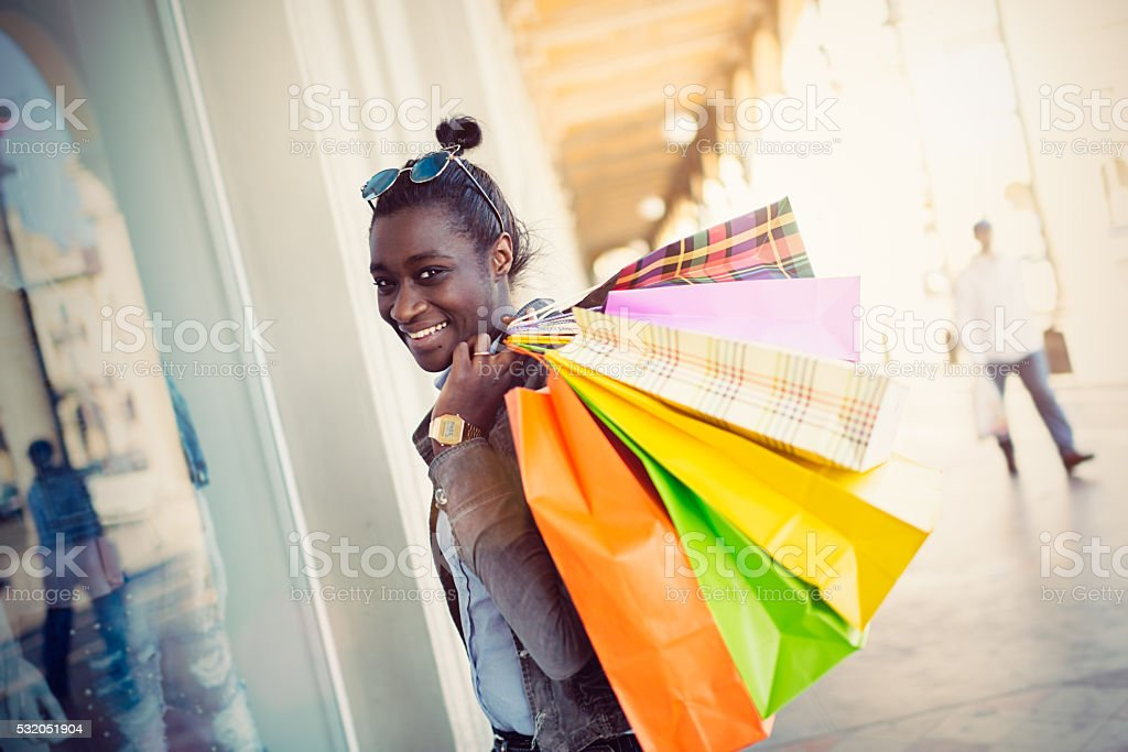 African European young woman with shopping bags stock photo