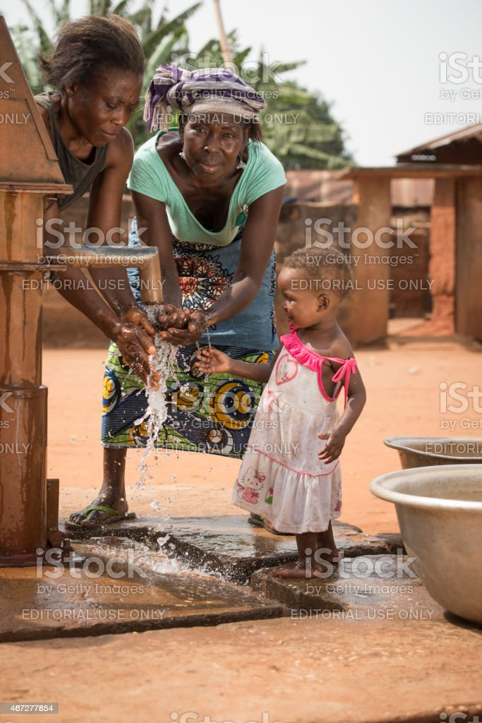 African family at a well stock photo