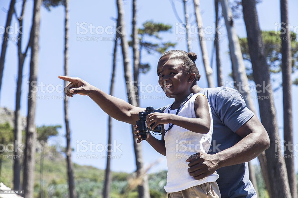African father pointing to show his daughter something royalty-free stock photo