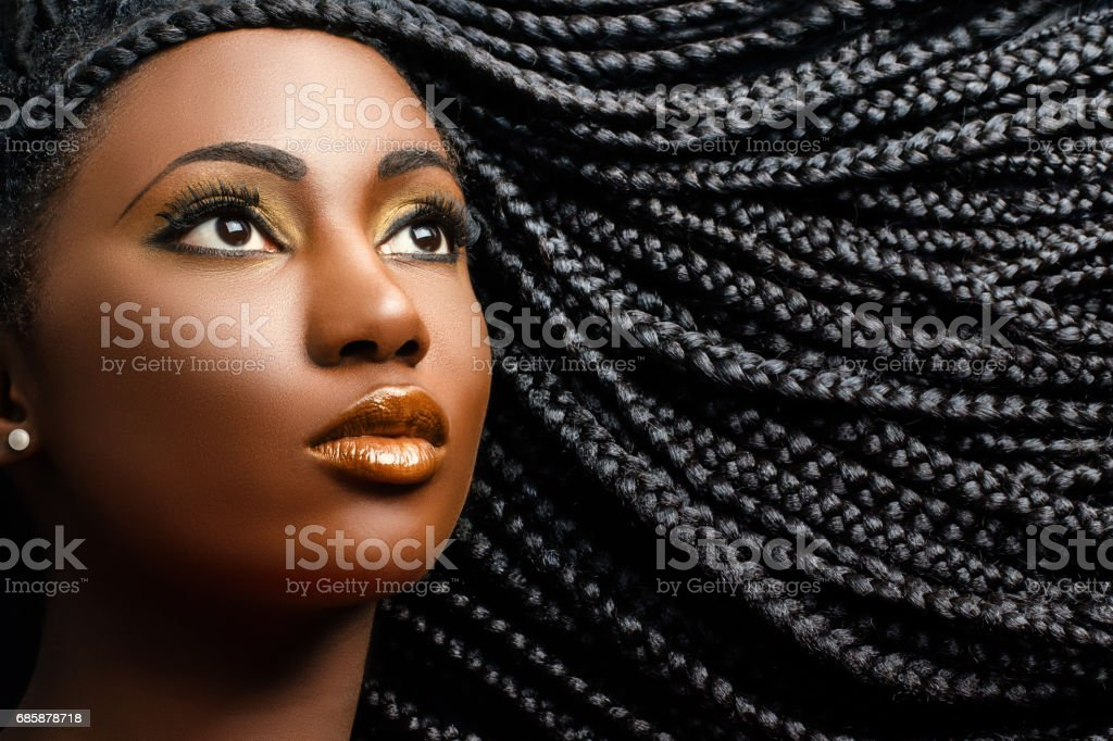 African female beauty with braided hair. stock photo