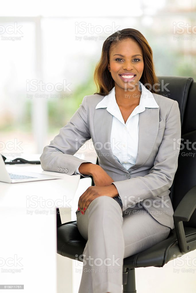 african female business executive in office stock photo