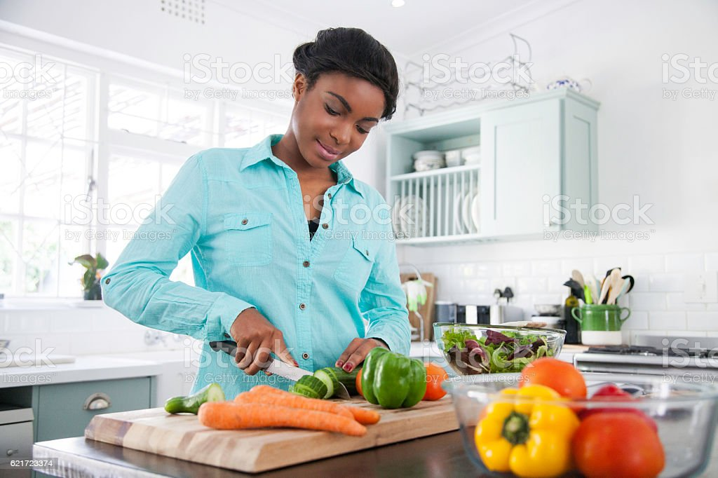 African female cooking up a storm. stock photo