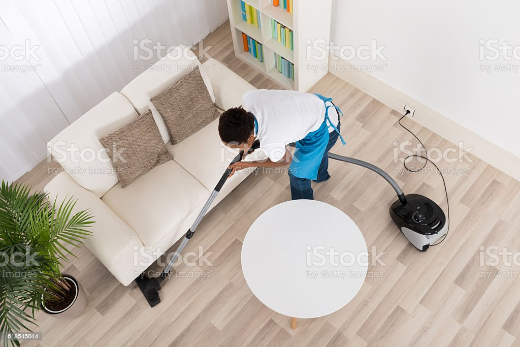 African Female Janitor Cleaning Floor stock photo