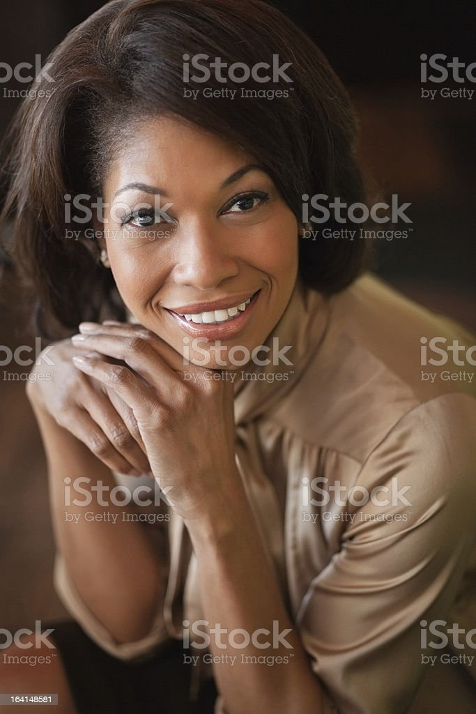 African Female With Hands On Chin royalty-free stock photo