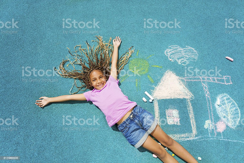 African girl and her chalk paiting stock photo