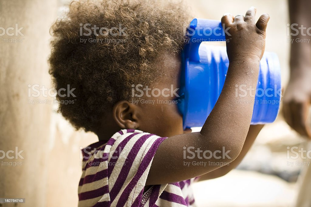 African Girl Drinking stock photo