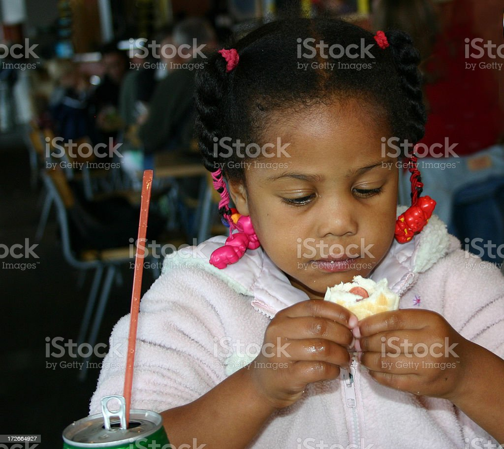 African girl eating stock photo