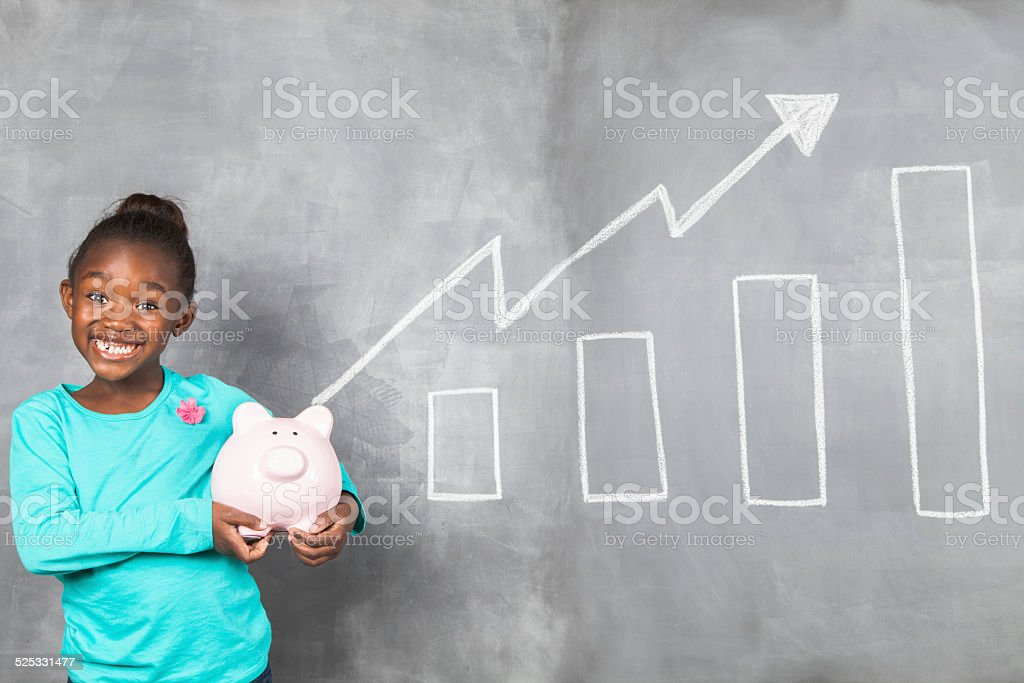 African girl excited about the amount of money she saved. stock photo