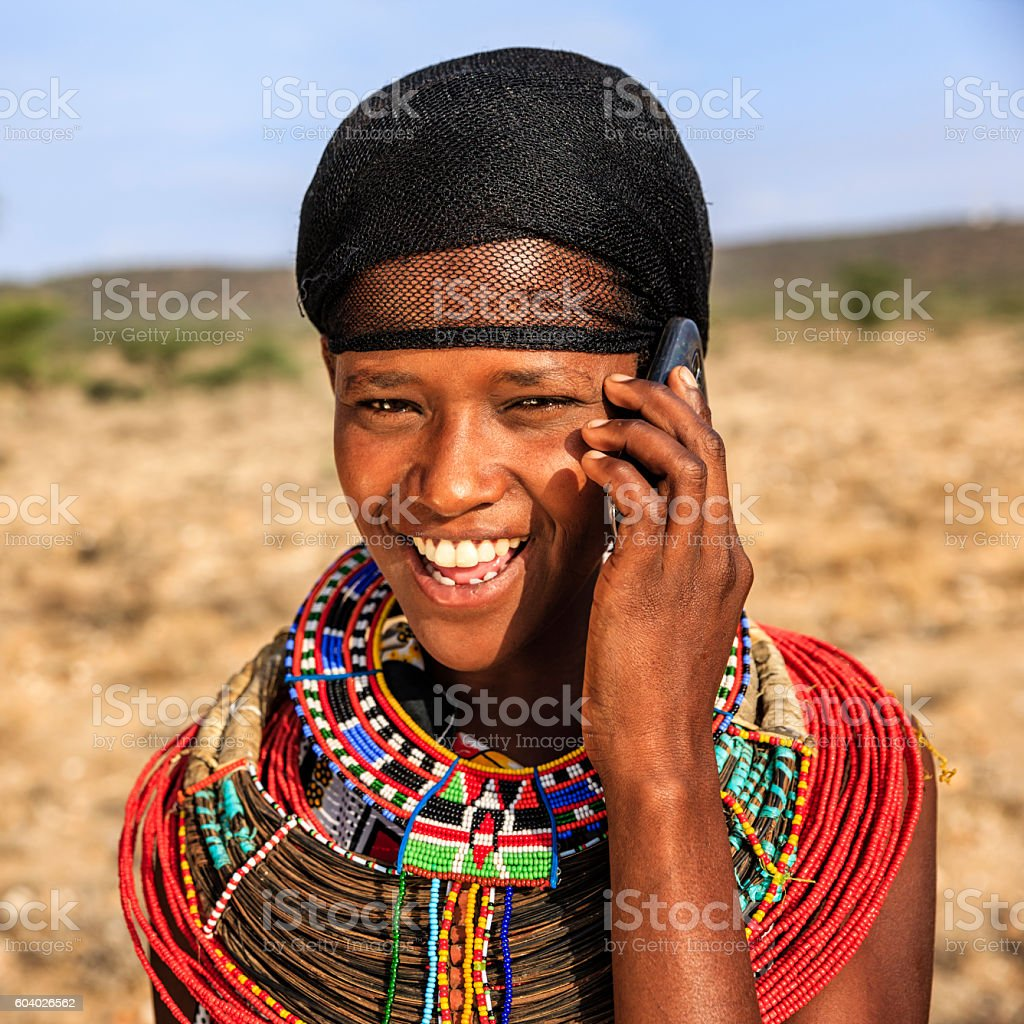 African girl from Samburu tribe using mobile phone, Kenya, Africa stock photo