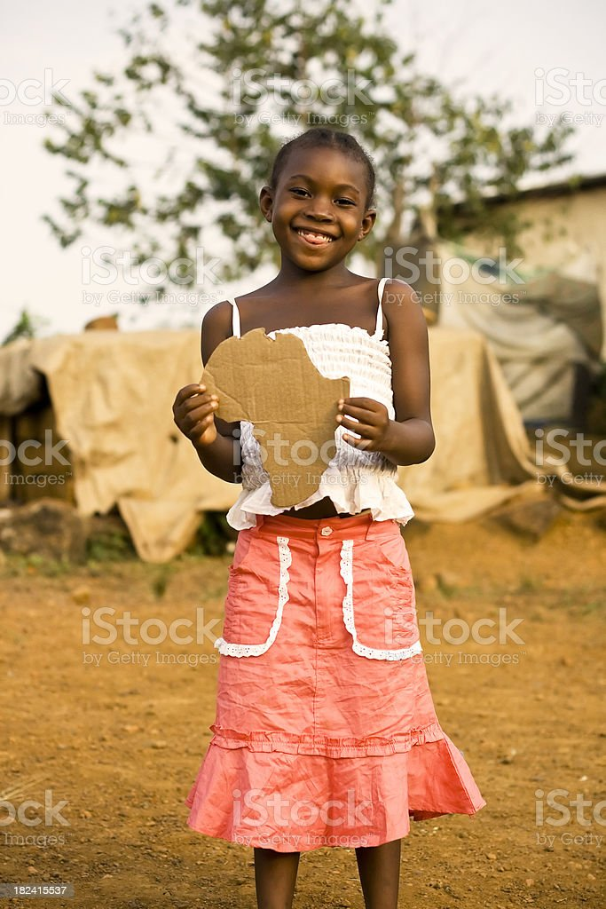 African Girl holding a Africa shaped sign royalty-free stock photo