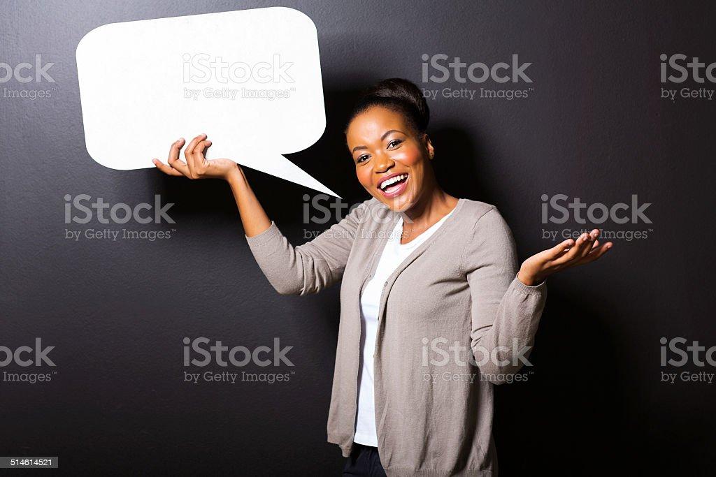 african girl holding blank speech bubble stock photo