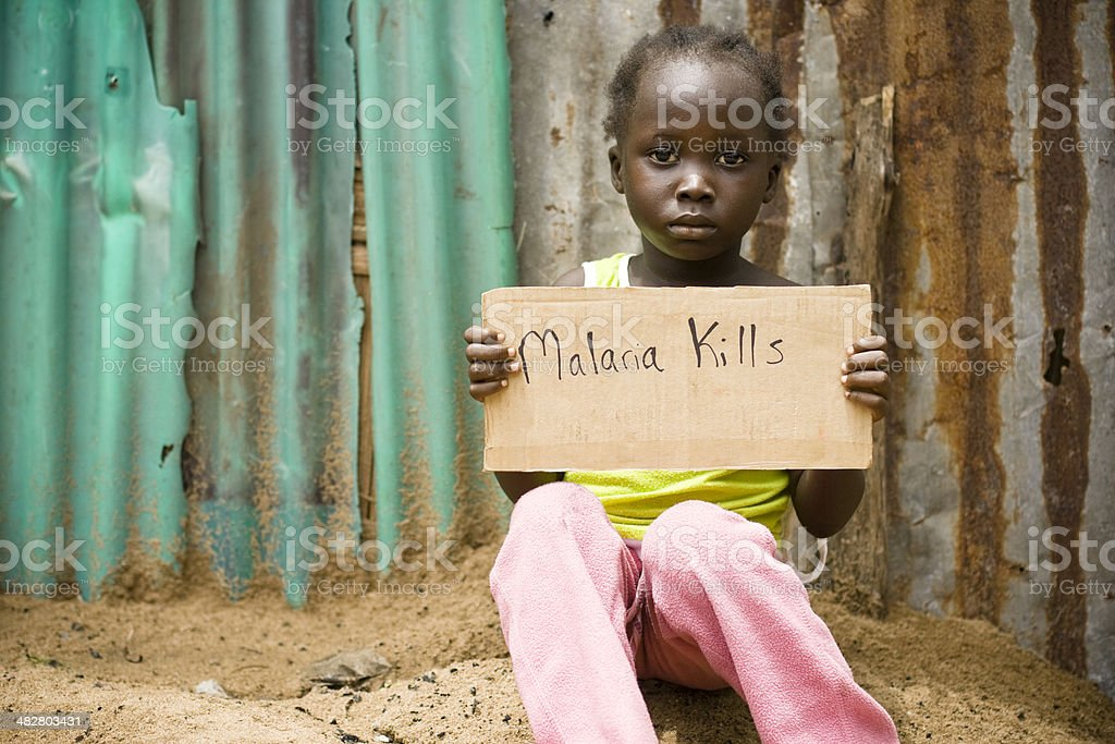African Girl Holding Sign With 'Malaria Kills' Written On It stock photo