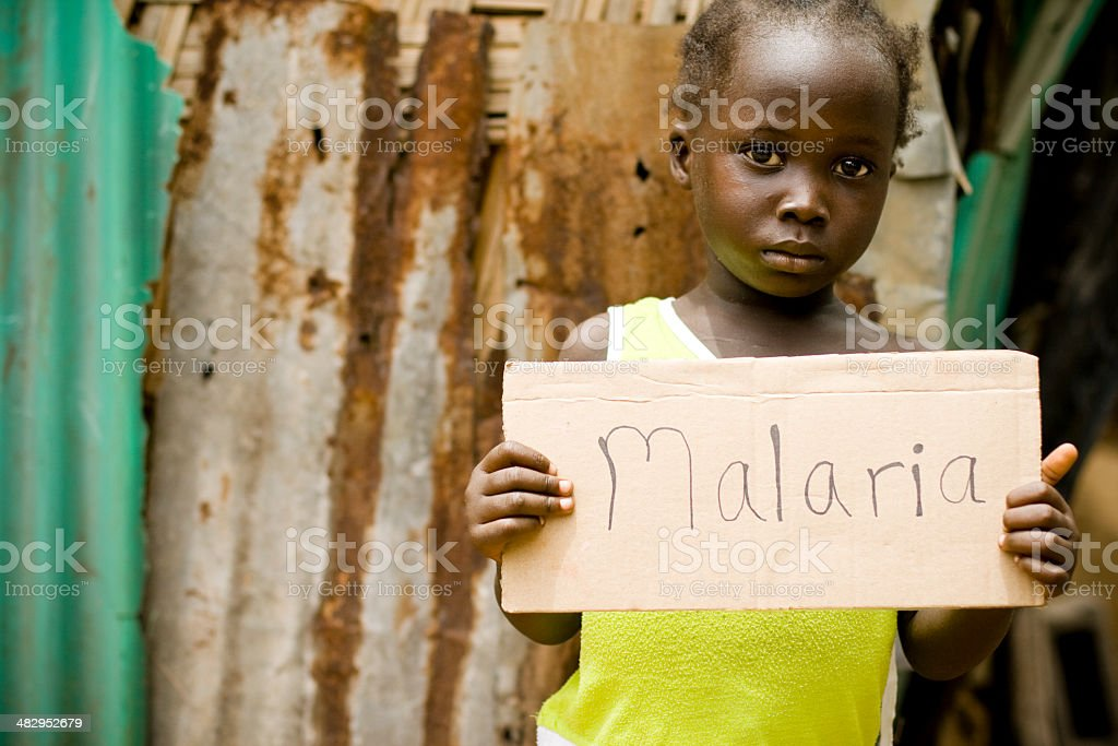 African Girl Holding Sign With 'Malaria' Written On It stock photo