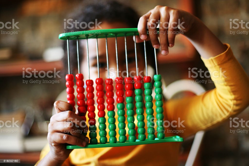 African girl learn abacus. stock photo