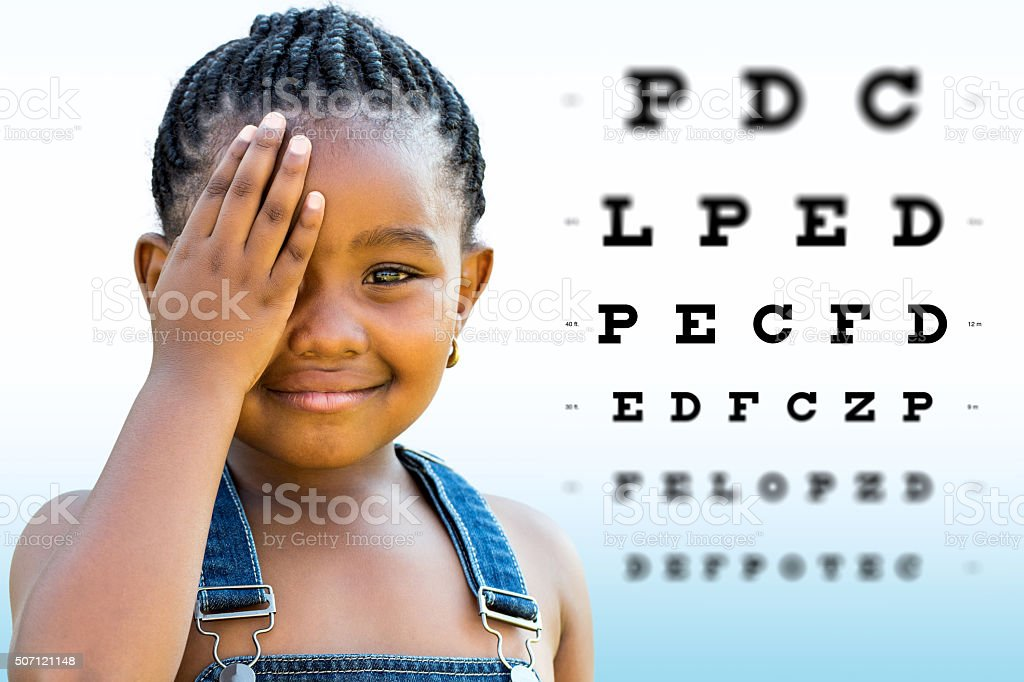 African girl testing vision. stock photo