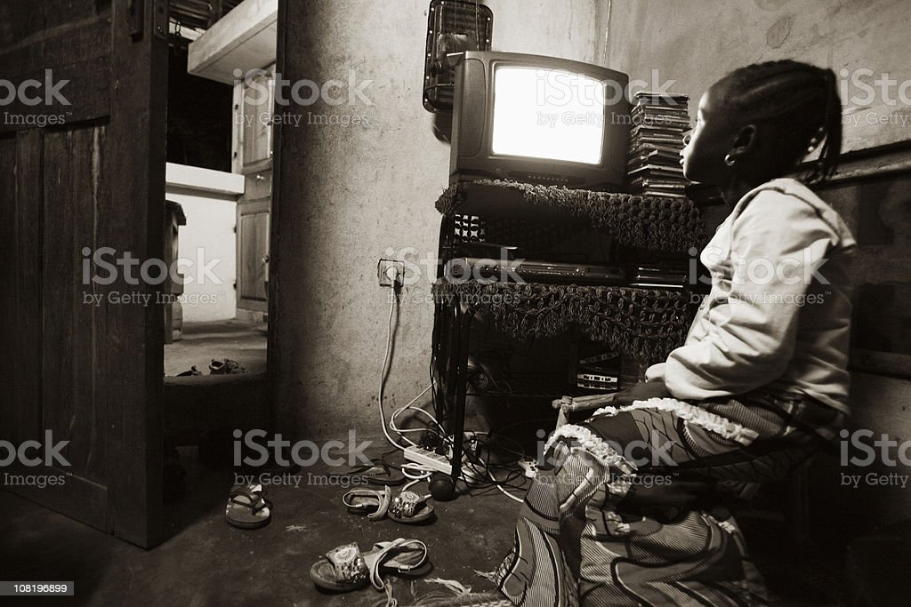 african girl watching tv royalty-free stock photo