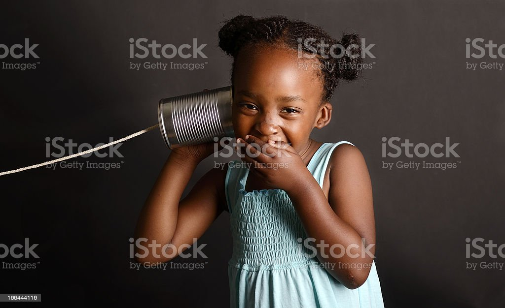 African girl with a tin and string on her ear royalty-free stock photo