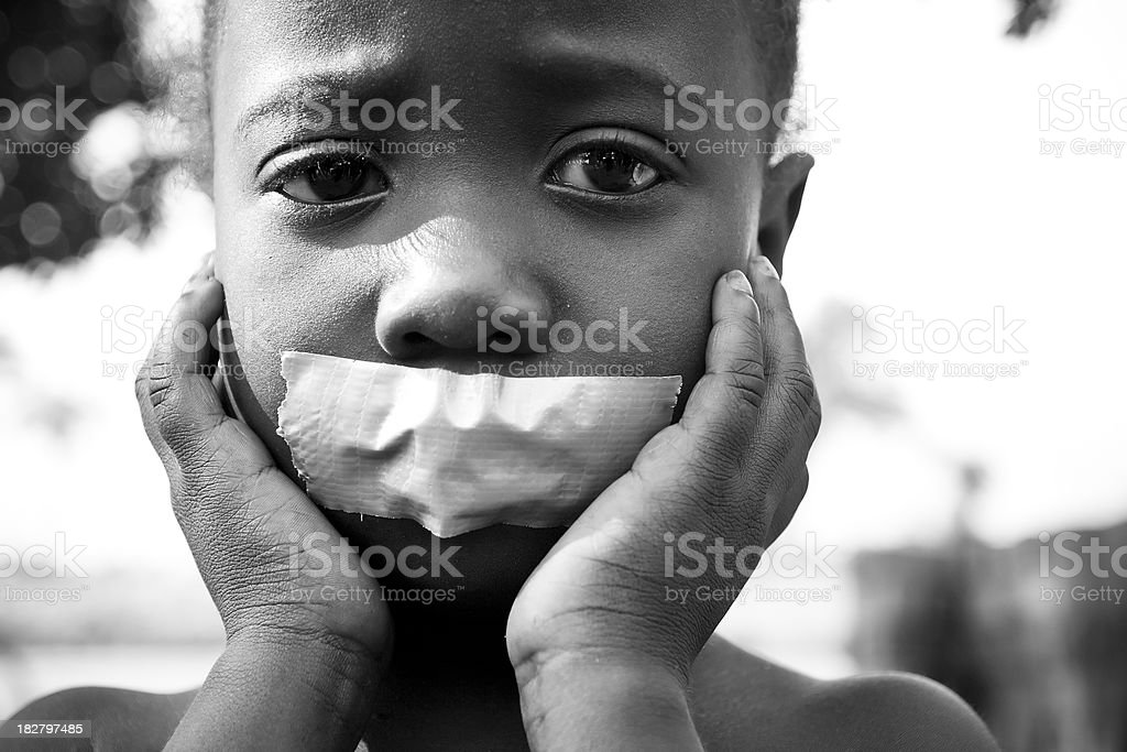 African Girl With Tape Over Mouth stock photo