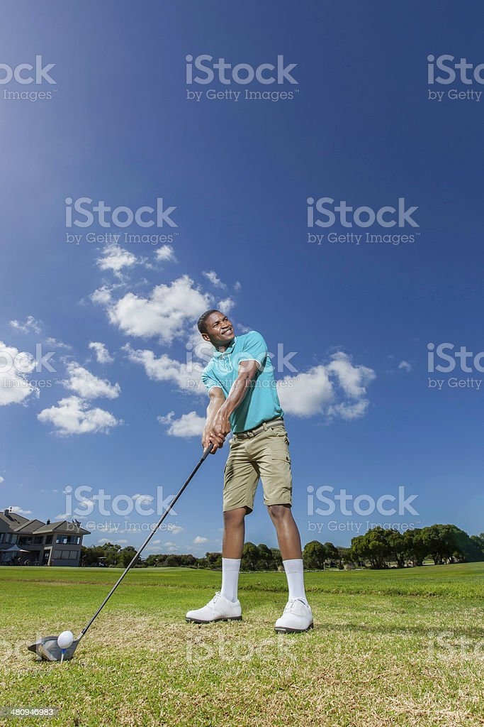 African golfer feeling good about his next hit royalty-free stock photo