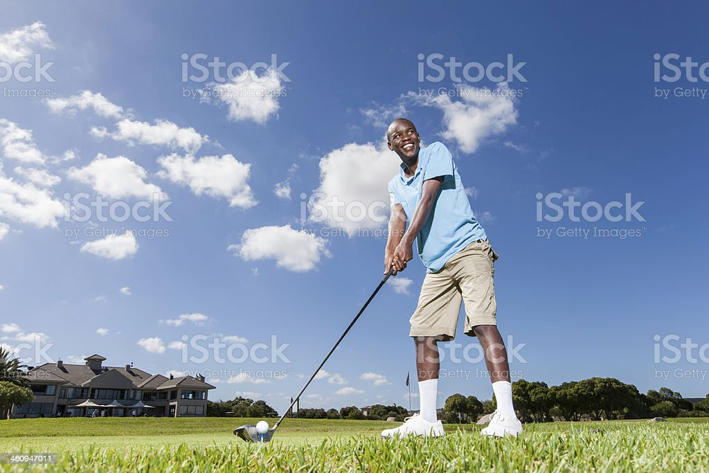 African golfer smiling royalty-free stock photo