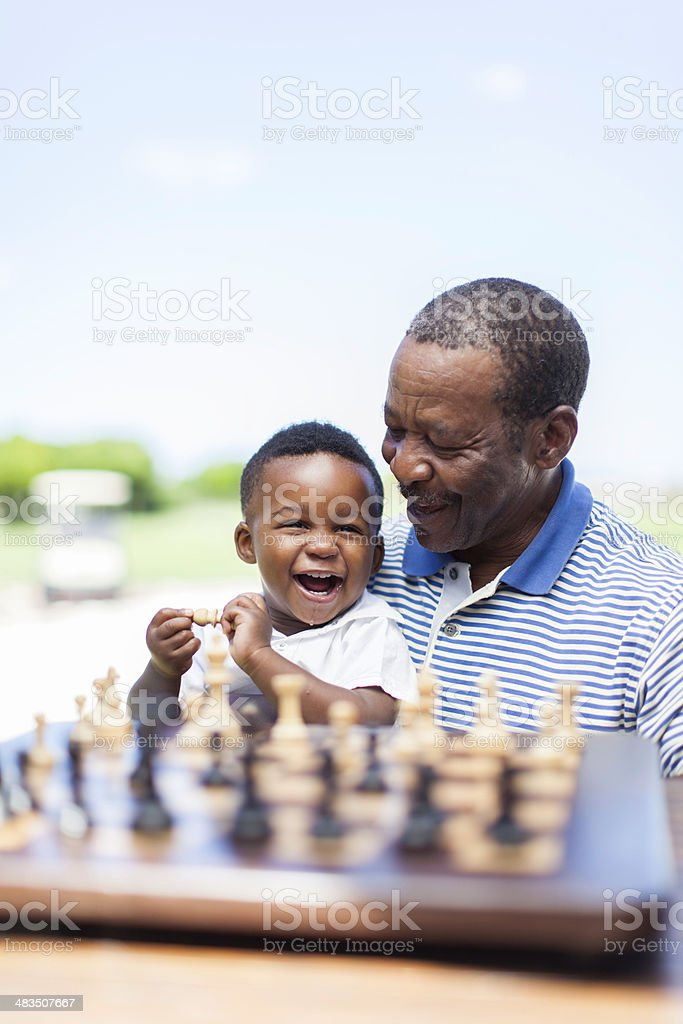 African grandfather having a good laugh with his grandchild royalty-free stock photo