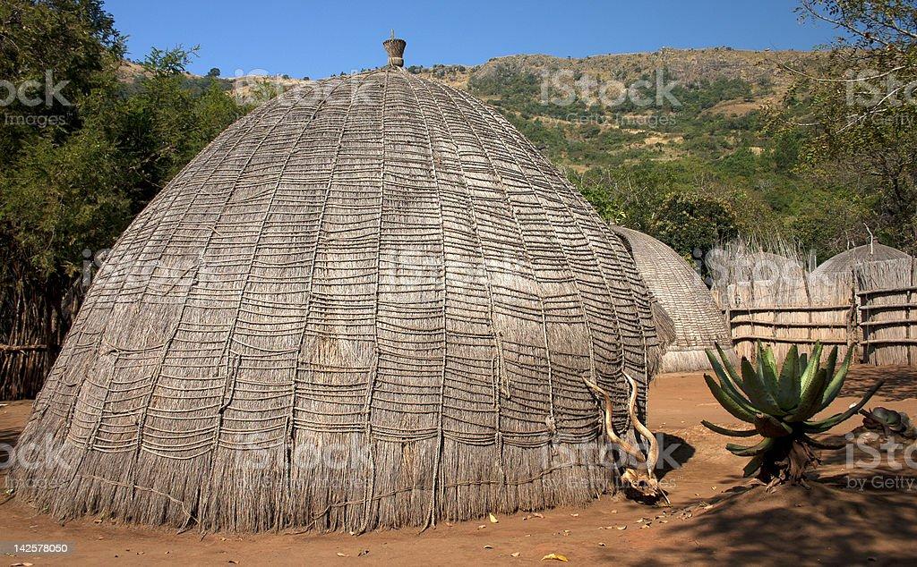 African grass hut stock photo