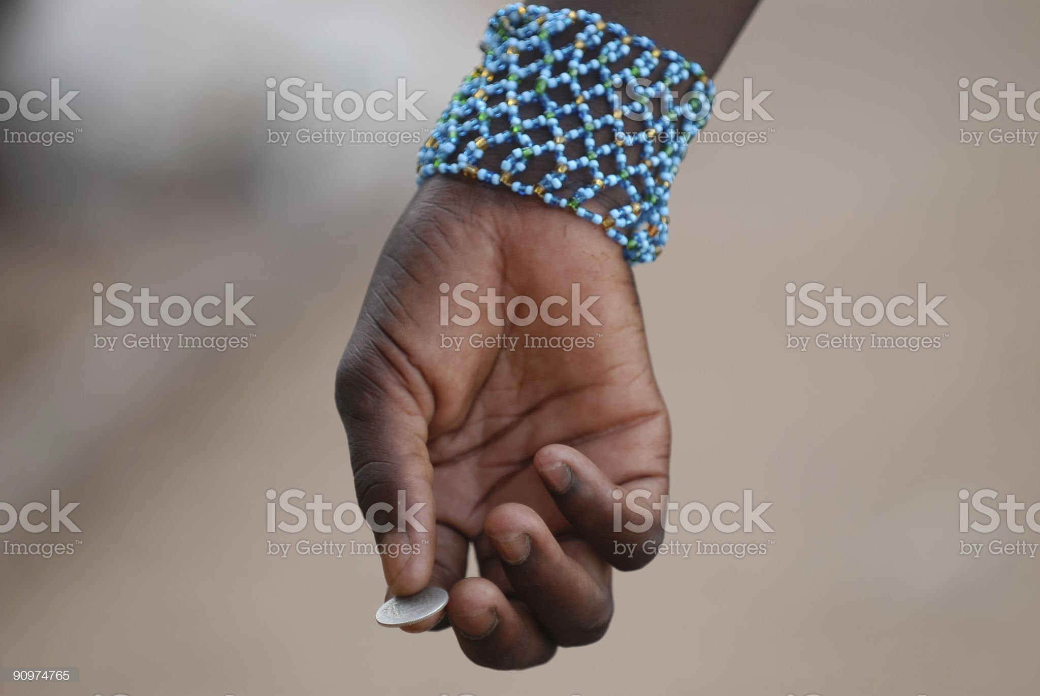 african hand with coin royalty-free stock photo