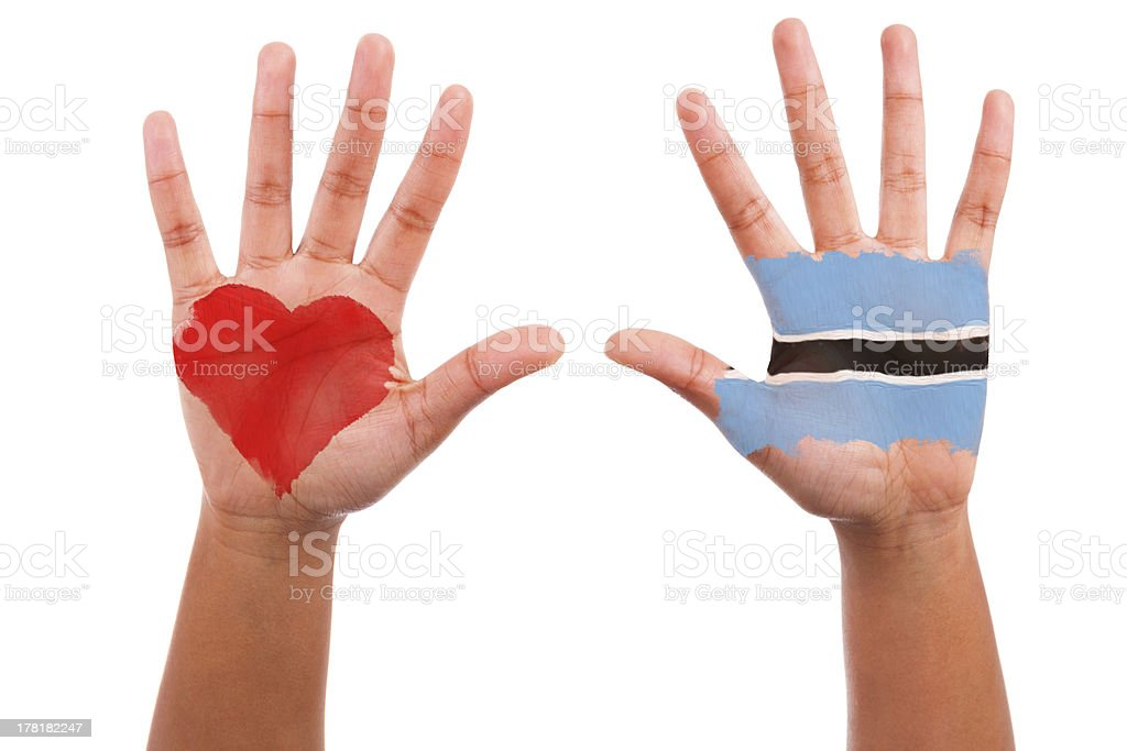 African hands with a painted heart and botswanian flag royalty-free stock photo