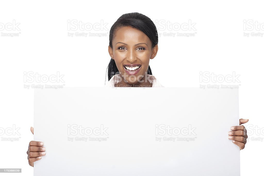 African happy woman with billboard / blank sign. royalty-free stock photo