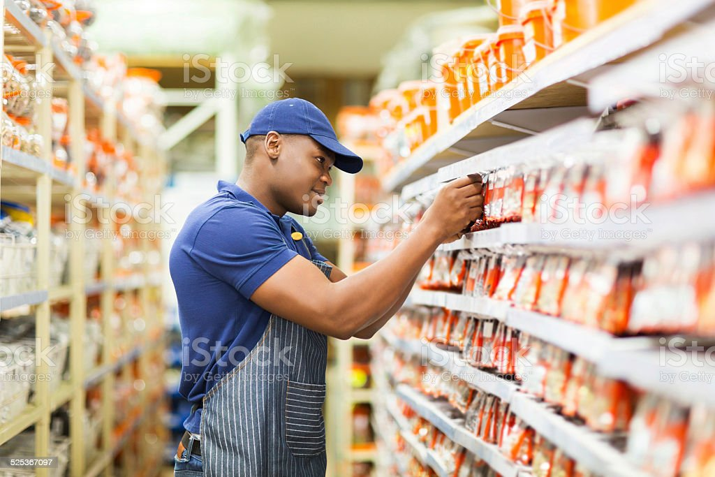 african hardware store worker working in the shop stock photo