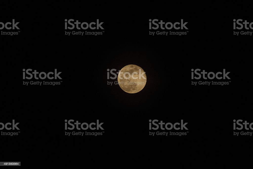 African Harvest Moon in Black Sky stock photo