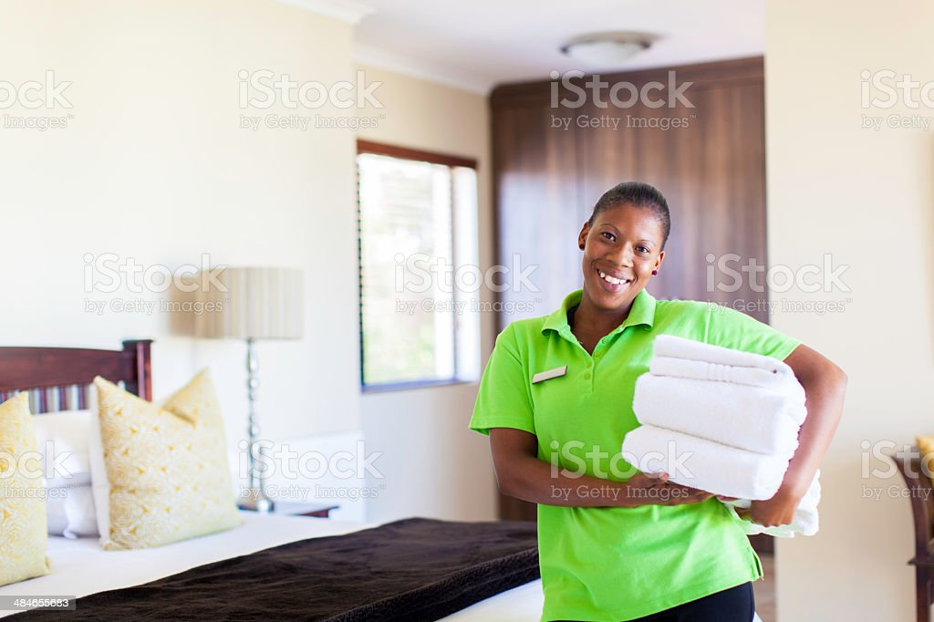 African housekeeper smiling at the camera stock photo