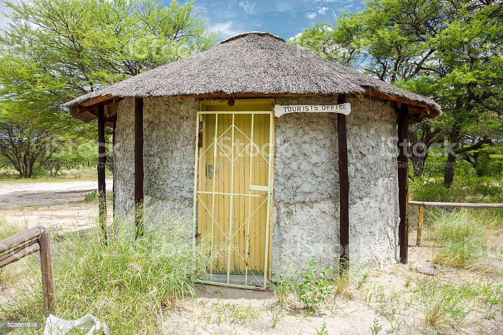 African Hut with the small tourist office in Central Kalahari stock photo