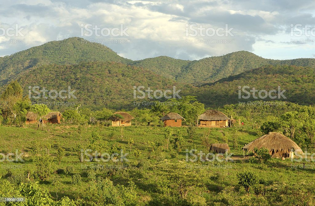 African huts in hills stock photo