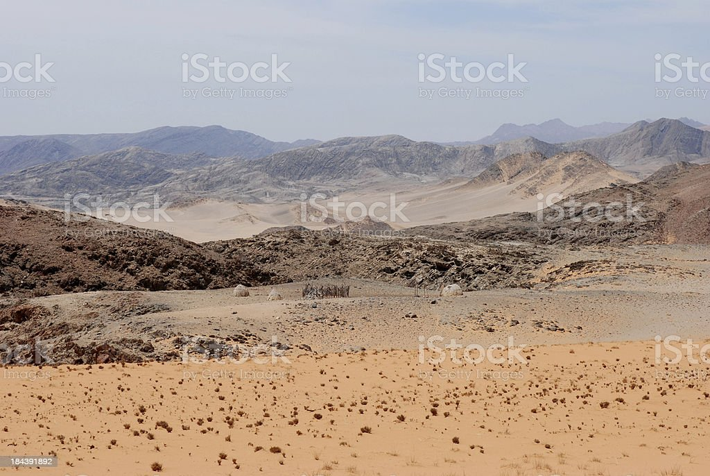 African huts in middle of desert, Himba Tribe, Namibia stock photo
