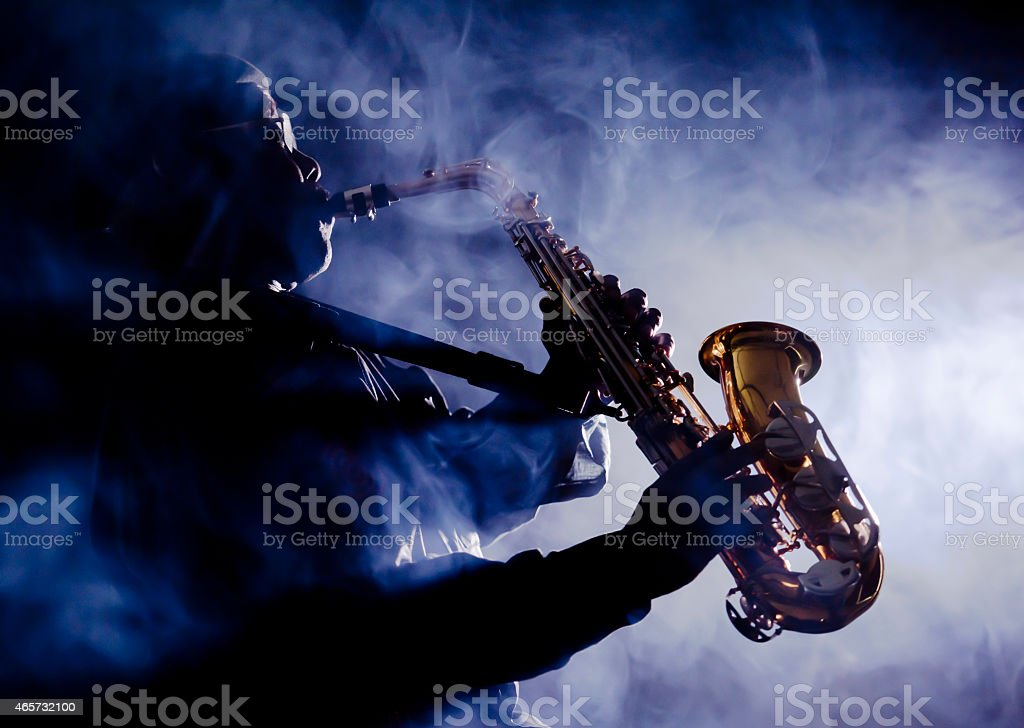 African jazz musician playing the saxophone stock photo