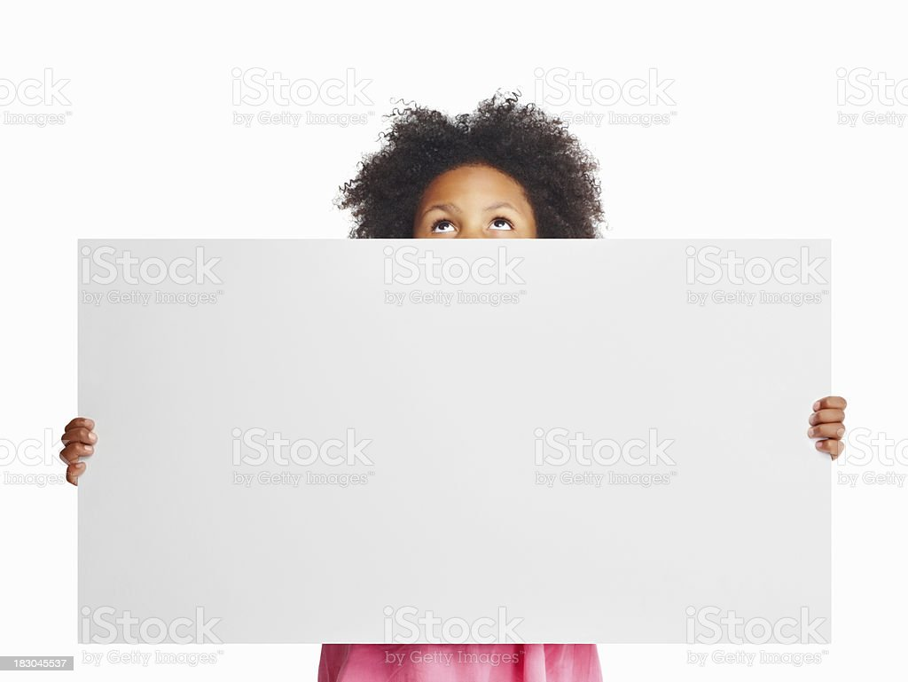 African kid looking up as she holds a billboard stock photo